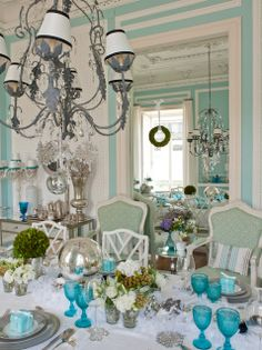 I love the soft aqua walls and pops of aqua accents on the table. So serene...