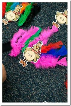 November- Turkey Math: Turkey has a math problem on his belly and kids use the feathers to solve.