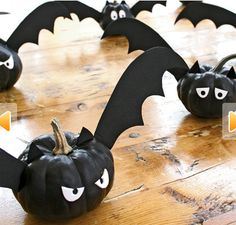 Use craft pumpkins painted black & black foam for wings/ears then hang from front porch.