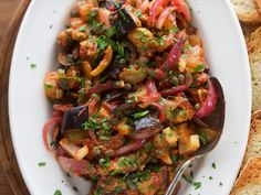 A colorful mix of eggplant, red onions, tomato sauce, olives and capers make up the backbone of this sweet and sour Sicilian staple. Eggplant Caponata, Roast Eggplant, Wine Recipes, Cooking Recipes, Veggie Recipes, Vegetarian Recipes, Vegetarian Dinners, Vegetable Dishes, Salad Recipes