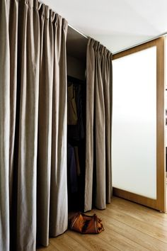 The walk-in wardrobe has a curtain 'door' to soften the look in the master bedroom. It can also be drawn over the room's frosted glass door to keep out external light or close the bedroom from view.