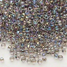 Matsuno Dyna Mite glass round seed beads, 50 gram bag, size Clear with Color Lined Peacock color, round hole. (multi AB color look). Seed Bead Bracelets Tutorials, Beaded Bracelet Patterns, Beading Tutorials, Beading Patterns, Bugle Beads, Seed Beads, Pony Beads, Bead Crafts, Doll Crafts