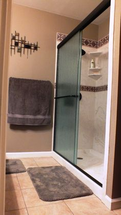 Cultured Marble Tub to Shower Conversion  Texas Burnt Almond Wall Panels with Caldera Listello Trim, 3/8's Heavy Rain Glass Oil Rubbed Bronze Trim, Corner Seat......