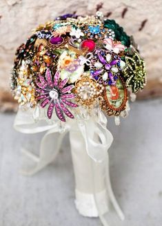 Every bride holds a bouquet, and it's a very important thing that helps to complete your bridal look. If you are looking for something special, go for a brooch bouquet. God, I just can't help admiring this cuteness!