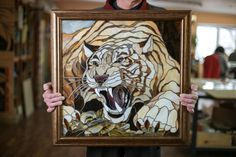 The tiger is made of stained glass and decorated into a framed picture. Tiger is belived to be a symbol of energy, power and talent. So it could beautify your home, office or any other place and could be a perfect present for person who is fond of animals. This picture is made made