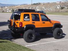 Jeep Liberty. Lifted. orange. badass. This is the dream