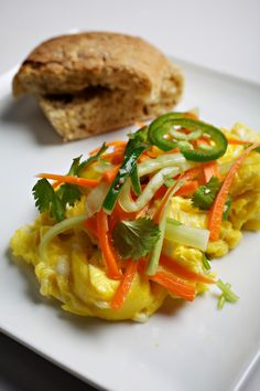 As it happens, the components of a banh mi with egg do quite nicely as a quick breakfast-for-dinner main dish: warm, creamy scrambled eggs topped with crisp vegetables, lightly dressed in the flavors of the classic Vietnamese sandwich.