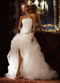 Make a statement as you walk down the aisle in the gorgeous organza gown!  Strapless organza high-low ball gown is breathtaking with pickups and adnored with beaded detail at the dropped waist.  Sweep train. Sizes 0-14. Available in Ivory and White in select stores and special order.   Available in stores and online in Ivory. Available in stores in White.  Fully lined. Back zip. Imported polyester. Dry clean only  Woman: Style 9SPK470. Sizes 16W-26W.  (special order only).