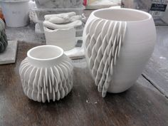 Ruth Harrison Ceramics: Current College Work - test pieces- attaching half disks to a thrown vessel.