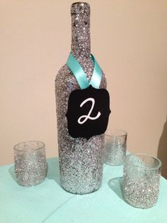 Glittered wine bottle table numbers Www.thefinaltouchevents.com