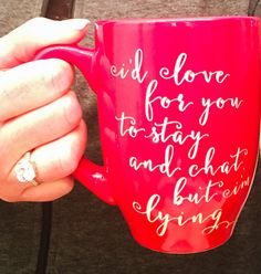 "This will make your guests uncomfortable! Passive agressive communication is always the way to go. ;) ""I'd love for you to stay and chat, but I'm lying""     Saying is etched into a red ceramic mug. Hand wash. Not safe for microwave or oven. 