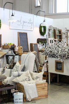 Limited colors in a craft fair booth grab the eye and keep the space looking tidy and clean, even with a lot of product