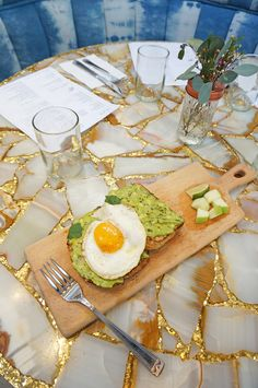Bohemian indigo hues meets gold-laden quartz tables for brunch at The Butcher's Daughter in Venice Beach