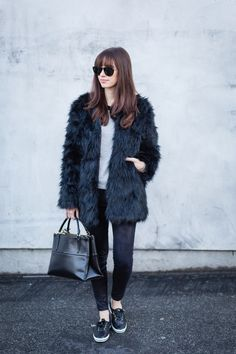 black faux fur jacket with sweatshirt and jeans via M Loves M @marmar