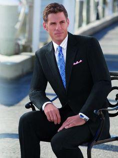 Signature Suits Grey Herringbone with a Signature Medallion Tie.