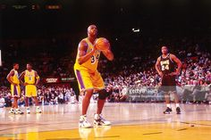 Shaquille O'Neal #34 of the Los Angeles Lakers attempts a free throw against the Sacramento Kings on March 25, 1998 at Staples Center in Los Angeles, CA.