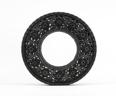 Wim Delvoye carves intricate patterns into old tires to give them new life as recycled art