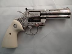 Colt Python A custom engraved example with the long barrel. Chambered in Magnum, the Python is part of Colt's snake series of revolvers. Long since discontinued, they are mostly collectable. Colt Python, 357 Magnum, Cool Guns, Stuff And Thangs, Custom Engraving, Airsoft, Firearms, Hand Guns, Revolvers