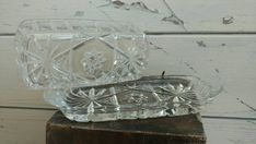 Check out this item in my Etsy shop https://www.etsy.com/listing/387311064/clear-glass-vintage-butter-dish-pressed