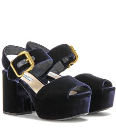 Prada - Velvet platform sandals - Prada gives the silhouette of the season an irresistible twist in plush blue velvet. The open-toe pair is finished off with a chunky strap to the ankle and is punctuated with a golden buckle detail for that slightly quirky, offbeat look we're going for. Let yours be the focal point of your party look for head-turning results. seen @ www.mytheresa.com