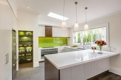 With its lively colour palette, timber accents and the latest Fisher & Paykel appliances, this new kitchen is especially inviting #kitchens #colourful #kitchencolour
