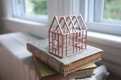 Small rose gold birch frame house - exposed painted wood structure - copper…