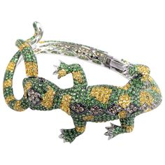 Multi Sapphire Diamond Lizard Bangle | From a unique collection of vintage bangles at https://www.1stdibs.com/jewelry/bracelets/bangles/