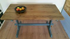 Blue/grey rustic industrial refectory table with wooden top.