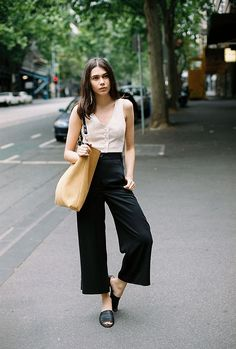 {Black wide legged pants and mules.}