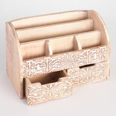 Elevate everyday office supplies with our handy, hand-carved organizer, featuring an intricately carved floral design and a subtle whitewash finish. With five compartments on top and two drawers below, it has everything you need to keep desktop clutter under control.