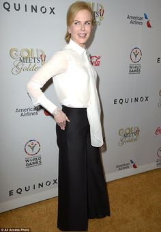 Monochrome: The Oscar winner dressed in a simple white blouse and wide-leg black trousers...