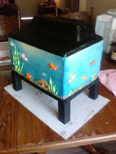 Fish tank cake — Animal cakecentral.com675 × 900Search by image Fish tank cake. I made this for my sons birthday, he loves fish, he wasnt satified with generic fish either, I had to make them look like actual species, ...