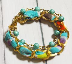 Graceful azure blue bead and rainbow fabric in chain bracelet