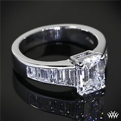 This+Custom+Diamond+Engagement+Ring+is+set+in+platinum+and+holds+1.10ctw+in+tapered+baguettes.+The+4+prong+head+holds+a+beautiful+1.59ct+Emerald+Cut+Diamond.