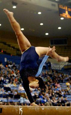 college gymnast with one hand on the balance beam, collegiate gymnastics, grace, form, UCLA  Bruins #KyFun