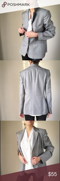 """ANN TAYLOR LOFT well tailored blazer. Fully lined ANN TAYLOR LOFT well tailored blazer. Two button up , collar, slim tailored waist. Size 8. Shoulder 16"""", bust 18.5"""" Waist 17.5"""". Arm sleeve24"""". Shell 100% wool *top of the line soft smooth wool. Non itch . Lining 100%acetate. The fabric primarily gray with feign blue silver plaid lines.Excellent new condition. Ann Taylor Jackets & Coats Blazers"""