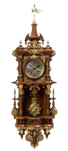 A German Gilt Metal Mounted Wall Clock  |  Fine Furniture and Decorative Arts Auction