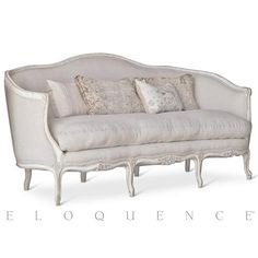 Slip into Old World grandeur with this gorgeous Eloquence® French Country sofa. Curvaceous and inviting, the weathered, white wood frame surrounds soft fog linen upholstery and a cloud-like cushion. Eight elegant legs are detailed with hand-carved florets for a refreshing finish.