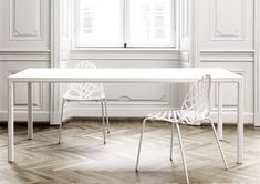 HAY T12 Dining Table is a super sleek design with an extremely slender profile, complemented with soft rounded edges. It's name is derived from the radius (12mm) of the curvature on the frame and tabletop. Available in various sizes, the HAY T12 table has a frame in powder coated aluminium (black or white) with a top in the same colour in wood (black or white stained ash, showing the visible grain).