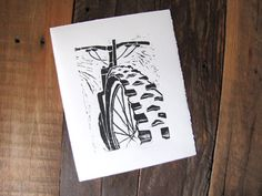 A unique print perfect for the mountain bike enthusiast! This hand-drawn perspective features the aggressive tread on a mountain bike tire, ready to grip the dirt and fly down the trail. Looks great framed in your home, bike shop or home workshop.  All of my linocut prints are hand-drawn, hand-cut on linoleum blocks, then inked and pulled by hand on premium paper. Each print is produced as a unique and handmade piece of art.  Size: 8 x 10 inches (203 × 254mm) Paper: 100% cotton BFK Rives…