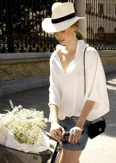 Hat, white blouse.