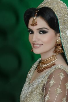Pakistani/Indian gold and silver bridal jewelry with stones (zevar): Necklace, tika, and jhumkas