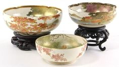Three Japanese Satsuma Bowls each artist signed, the first featuring a waterfall scene with bird (2 x 5 in. diameter; chip to foot rim); the second with birds in a village scene and lobed rim, 2.5 x 6.75 in. diameter; no apparent condition concerns, the third with foliate rimmed bowl featuring wisteria in a pagoda landscape, 2.25 x 5 in. diameter; no apparent condition concerns. Wood stands are excluded.