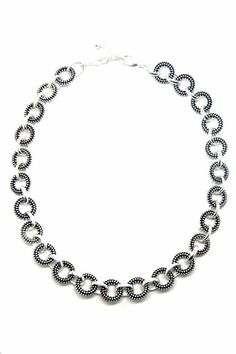 Multiple Link Textured Circle Necklace in Silver; oxidized links create high contrast and relief when paired with high-shine, super buffed silver toned links. Textured Circle Necklace by Made It!. Accessories - Jewelry - Necklaces New Jersey