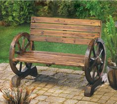 Just imagine yourself sitting outside enjoying your garden and the fresh air in this rustic wood garden bench featuring wagon wheel arm rests. This bench can be used in a garden are or you can use ...
