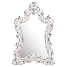 """Add a touch of charm to your decor with this lovely wall mirror, showcasing an antique white-finished frame and Baroque-inspired silhouette.    Product: Wall mirror Construction Material: Resin and mirrored glassColor: Antiqued white frameFeatures: Baroque-style aestheticDimensions: 46"""" H x 33"""" W"""