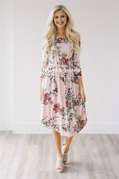 This dress has been one of our most highly anticipated releases, don't miss out! Beautiful light pink spring dress features long sleeves, a pretty floral print, an elastic waist and has cute front pockets.