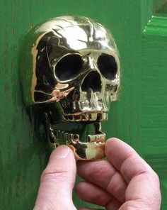 This Unusual Door Knocker is Scary and Skull-Shaped trendhunter.com
