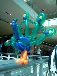 We're suggesting this idea to our Something Floral / Something Spectacular floral clients who are having a peacock feather themed wedding. Hire someone to make these peacock balloon animals for the young guests (children) attending your peacock themed wedding.