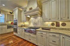 Beautiful kitchen with double oven. Nice cabinets and hardwood floors.